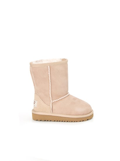 classic shearling boot in light beige color with A Twinface sheepskin. grey sole and woven logo on heel.  - UGG - Classic Boot