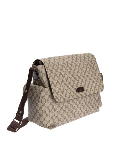 Beige plastic coated bag for baby accessories, GG-supreme print, brown interior, three inside pockets, changing mat included, two side flap pockets, outside pocket on the back, adjustable shoulder strap with brown stroller attachment with snap buttons, velcro closure. - Gucci - Mom bag