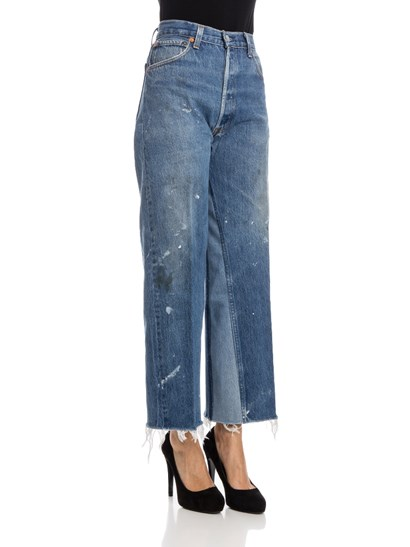 Blue cotton crop jeans with light stone washed, spots of color, light blue denim detail, cut edge bottom, buttons closure. - Levi's - 5 pocket jeans